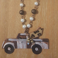 White Truck with Leopard Wings Necklace