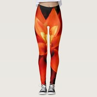Black and orange star flower burst leggings