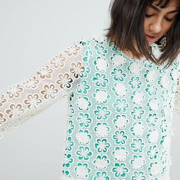 River Island Fluted Sleeve Flower Applique Top at asos.com