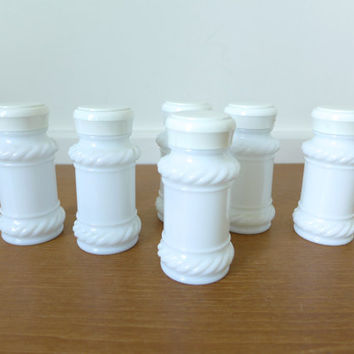 Six milk glass spice jars in excellent condition