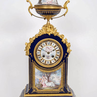 An Ornate Gilt-Bronze Mounted Sèvres Style Blue Ground Mantel Clock