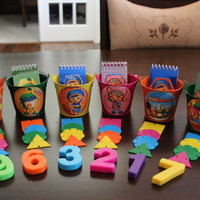 Team Umizoomi Party Favor Kit...Includes 6 Tin Pails, 6 notepads, 24 geometric shapes, & 6 magnetic numbers...everything you need!