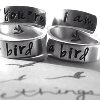 If you're a bird I am a bird set of two aluminum swirl version style rings 1/4 inch