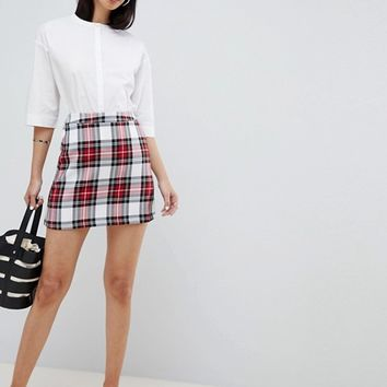 ASOS DESIGN tailored a-line mini skirt in red check at asos.com