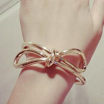 Bold Golden Bow Statement Bangle - LilyFair Jewelry