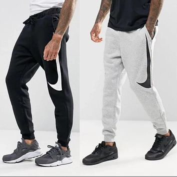 timeless design a2738 95f13 Nike Fashion Classic Women Men Leisure Big Hook Print Sport Pant