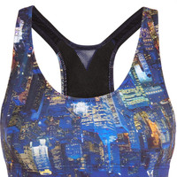 Lucas Hugh | Liberty city-print sports bra | NET-A-PORTER.COM