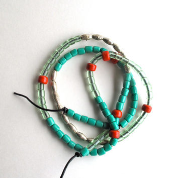Long beaded necklace Ethiopian silver plated beads Native American glass mint green coral beads on black leather cord asymmetrical design