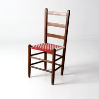 antique ladder back chair with woven fabric seat
