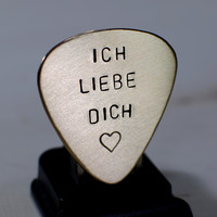 Guitar pick in bronze with Ich Liebe Dich
