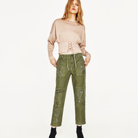 PRINTED TROUSERS WITH PATCHES DETAILS