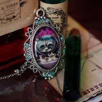 Alice in wonderland Cheshire cat cabochon covered by DevilsJewel