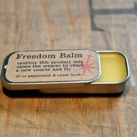 Lip balm peppermint sweet birch scent beeswax balm in .25 oz slide tin, brown cream beige yellow