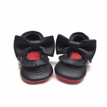Black Mary Janes with red sole