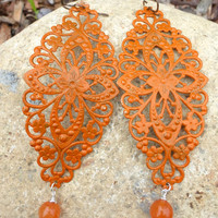 Orange Long, lightweight filigree metal and stone earrings.