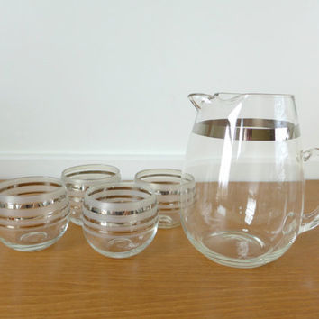 Set of silver rimmed roly poly glasses and pitcher, cocktail set