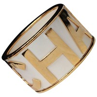 1990s Gilded metal and white enamel cuff bracelet