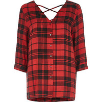 Red check print cross back long sleeve blouse