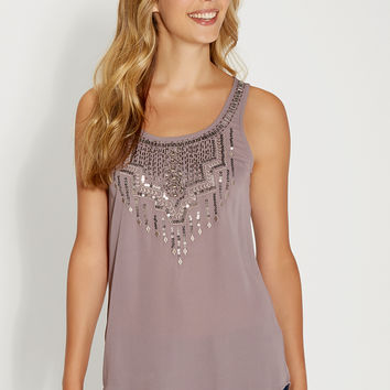 sleeveless blouse with embroidery, beading, and sequins
