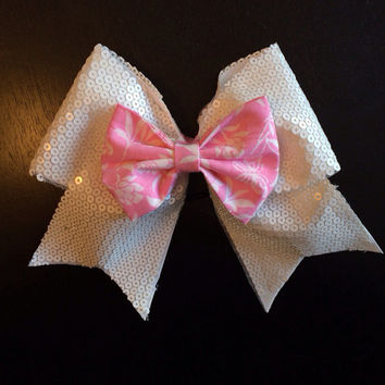 White sequin cheer bow with a pink mini in the middle