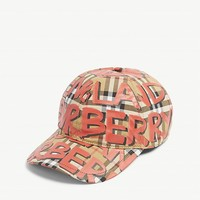 BURBERRY - Graffiti print house check baseball cap | Selfridges.com