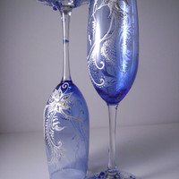 WOW looking Wedding champagne glasses in royal blue and pearl, perfect for your winter wedding or as a Christmas eve table glassware