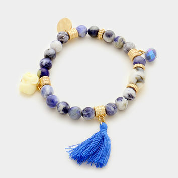 Matte Gold & Blue Semi precious stone beaded stretch bracelet with tassel elephant charm
