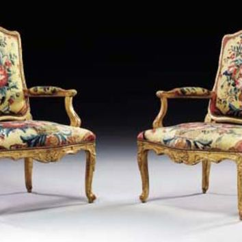 A PAIR OF EARLY LOUIS XV GILTWOOD FAUTEUILS , CIRCA 1735
