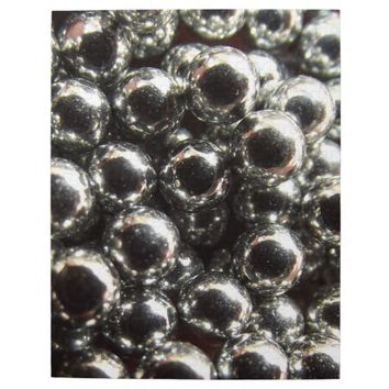 Closeup Photo of Shiny Silver Ball Bearing BB's Puzzle