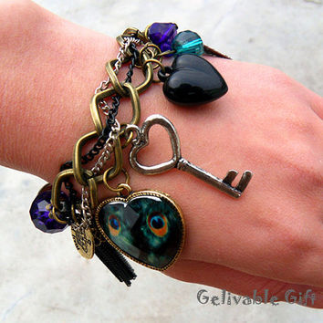 Peacock bracelet with colorful crystals elastic band chain,with love key,heart beads,piercing leaf and tassels pendants BP01