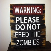 Sign: Warning please don't feed zombies from Ott Creatives