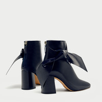 LEATHER HIGH HEEL ANKLE BOOTS WITH BOW DETAILS
