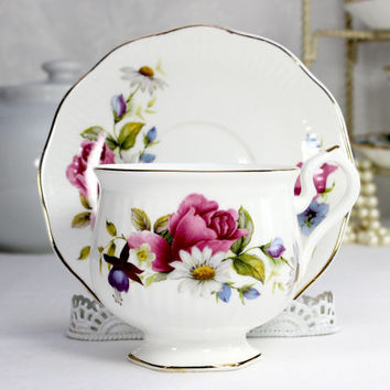 Enesco Footed Teacup and Saucer Made in Japan 12424
