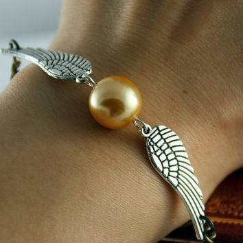 Golden snitch braclet harry potter bracelet by BeautyandLuck