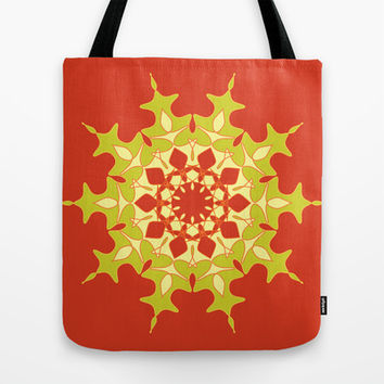 Artistic green mandala on red Tote Bag by cycreation