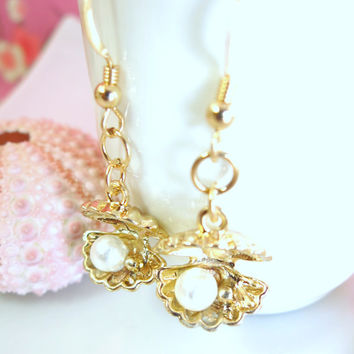Gold pearl shell dangle earrings
