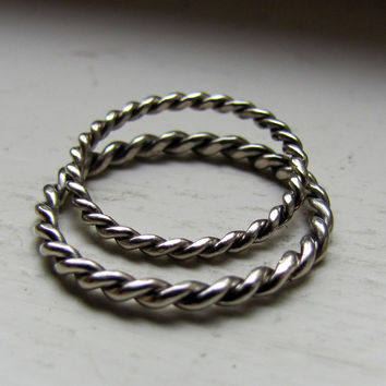 Unique solid gold hand twisted wedding rings