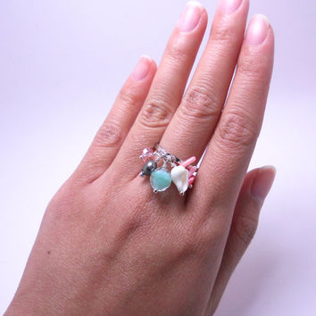 Silver band charm ring with pink coral, crystal, freshwater pearl, seashell, and sea green glass