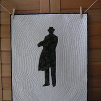 Mystery man quilted wall hanging