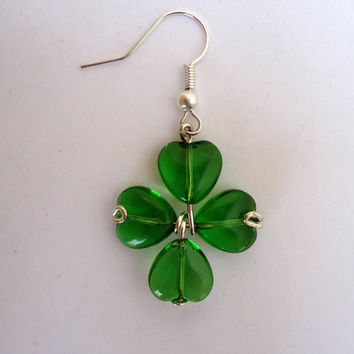 Dangling  shamrock earrings  with green heart glass beads and silver tone hypo allergic ear wires.