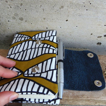 Moleskine cover with african print. Fabric cover in mustard and black with recycled leather flap. Unisex moleskine cover pocket size