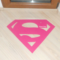 Floormat made with a Superman logo. Sign doormat.