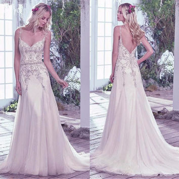 2017 Summer Boho Backless Wedding Dresses Romantic V-neck Spaghetti Straps Beaded Bohemian Bridal Gowns with Train
