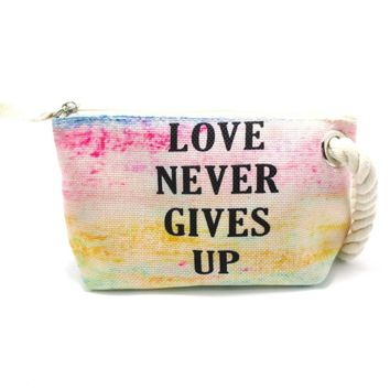 Love Never Gives Up Rainbow Watercolor Fabric Clutch Make Up Bag | DOTOLY