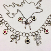 Bullet jewelry. Bracelet and necklace set with bows.