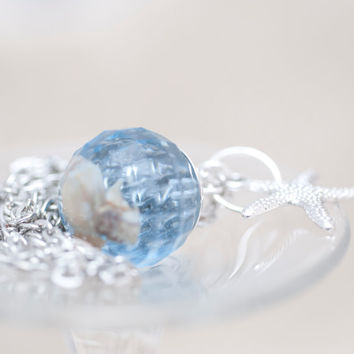 Light blue faceted ball pendant, shells immersed in epoxy resin jewelry and silver plated starfish.