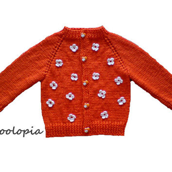 Baby cardigan, jacket, sweater for infant and toddlers; orange, embellished with hand crocheted flowers. Handknit