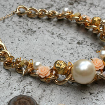 Wire wrapped Statement Necklace. 24 mm large Pearls, metallic Skulls, glass Roses , Crystals, gold plated Chain.