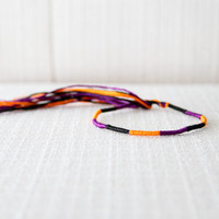 Friendship Bracelet Purple Orange and Black Embroidery Threads