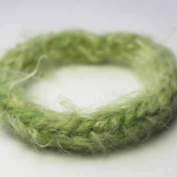 one fuzzy green and beige knit bracelet, furry caterpillar